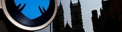 A branch of Barclays Bank is seen opposite Westminster Abbey in central London